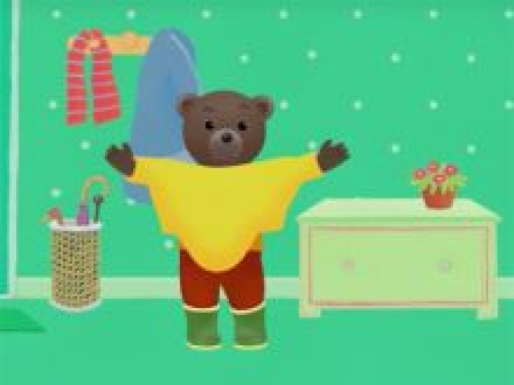Petit Ours Brun met son manteau